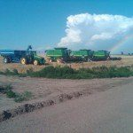 John Deere Combines in Field with Thunderstorm Approaching